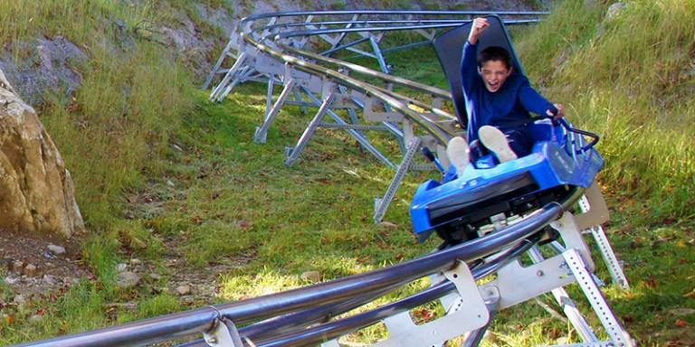 Young Boy riding the ADG Mountain Coaster