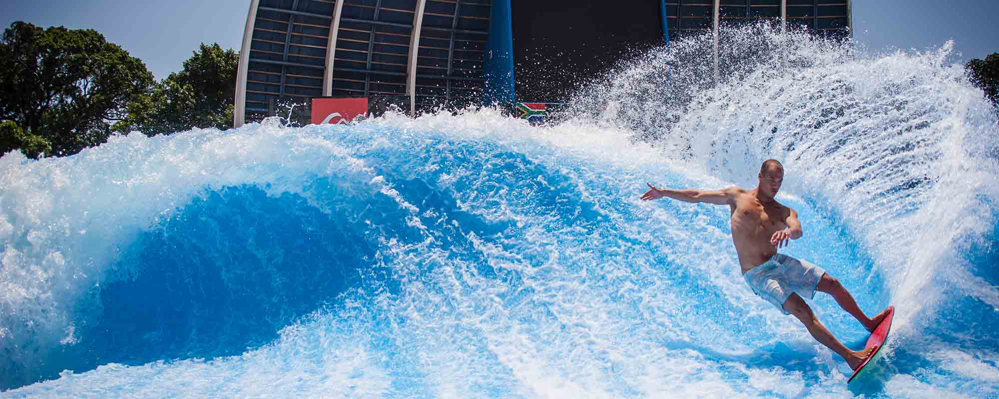 A man surfing on a giant wave on the flowrider