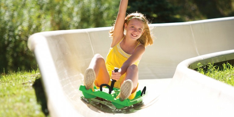 Young girl riding the ADG Mountain Slide
