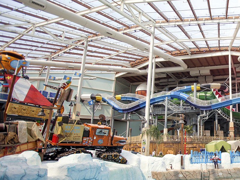 Aquatopia indoor waterpark with the slides and texlon roof above