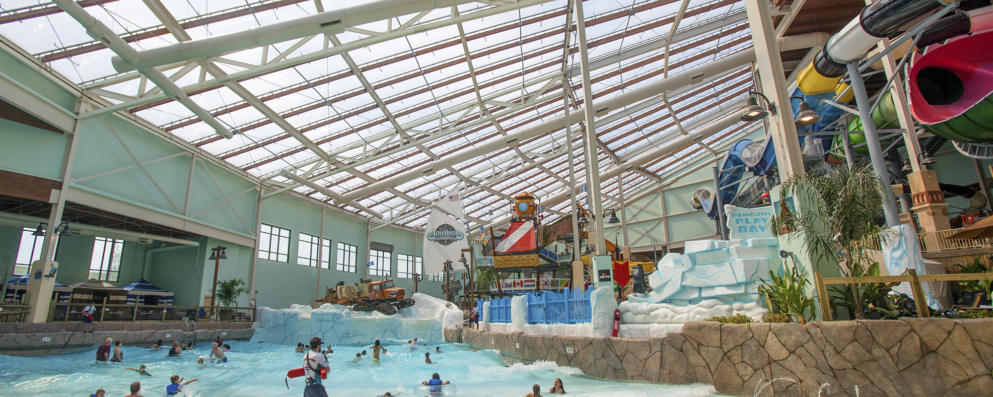 View of Aquatopia Waterpark with the wavepool, slides and the texlon roof above