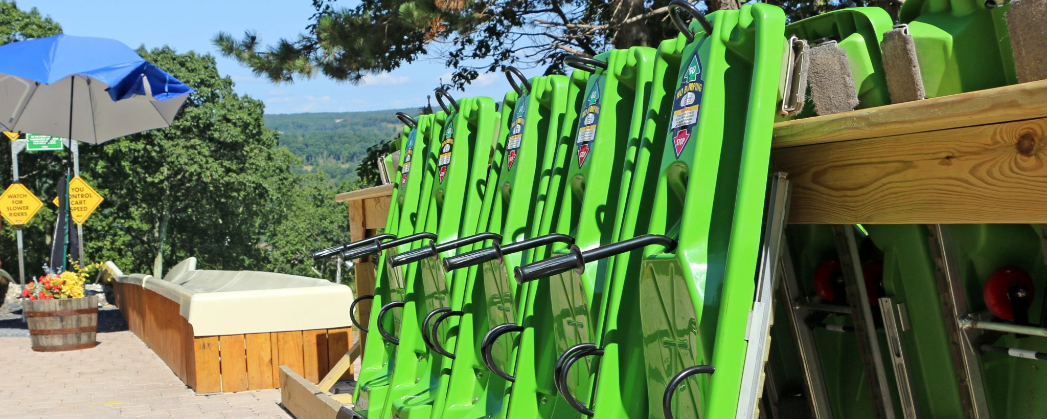 Bright green alpine slide carts at the top of the mountain