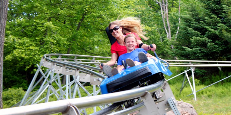 Mother and Daughter riding the ADG Mountain Coaster