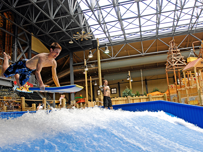 A kid riding the flowrider at Silver Mountain