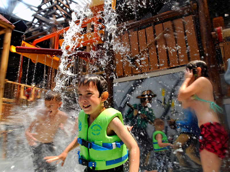 Young kid getting splashed at Silver Mountain