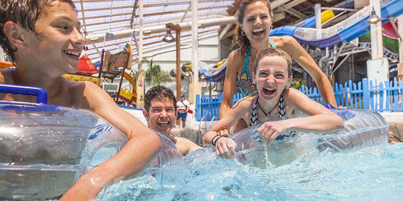 Family enjoying the wave pool at Aquatopia Indoor Waterpark
