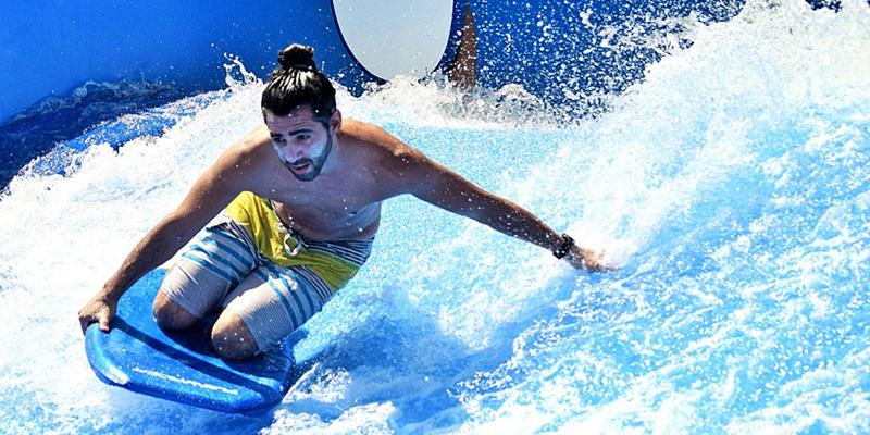 Man Surfing on the FlowRider at Margaritaville Resort