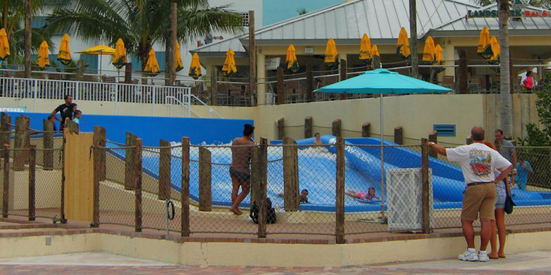 Passerbys on the Hollywood Boardwalk Viewing the FlowRider in Action