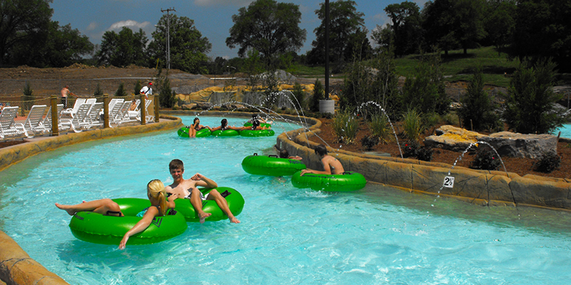 Guests Floating Along the Lazy River in Green Tubes.