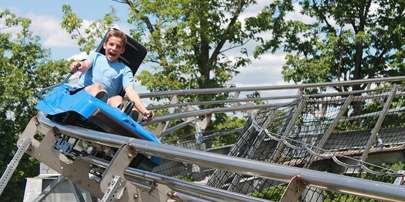 Boy Riding the Mountain Coaster