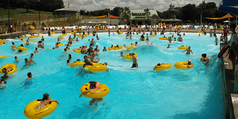 Guests Floating in Yellow Tubes in the Wave Pool.