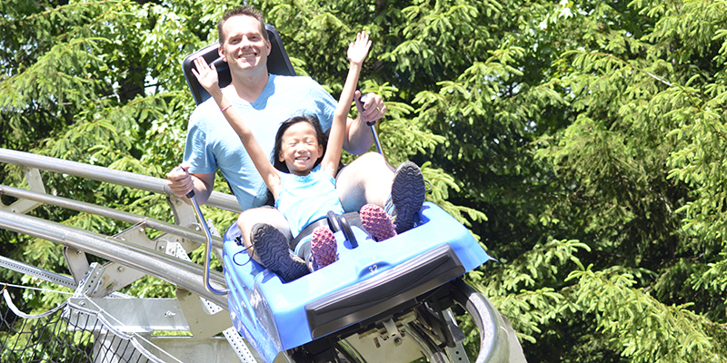 Man and Daughter on Mountain Coaster
