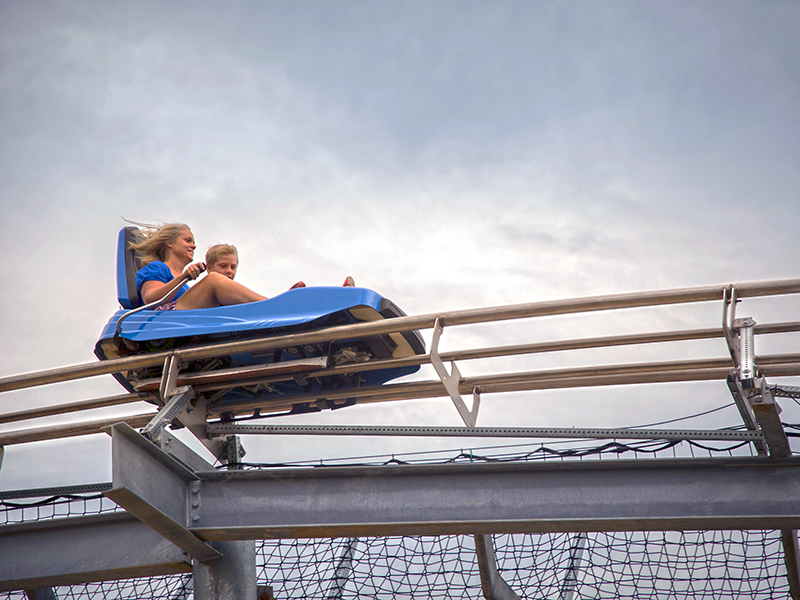 A woman and young boy on the Branson Coaster.