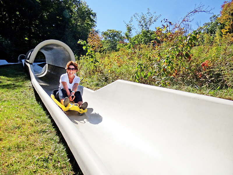 Woman Coming Down the Slide