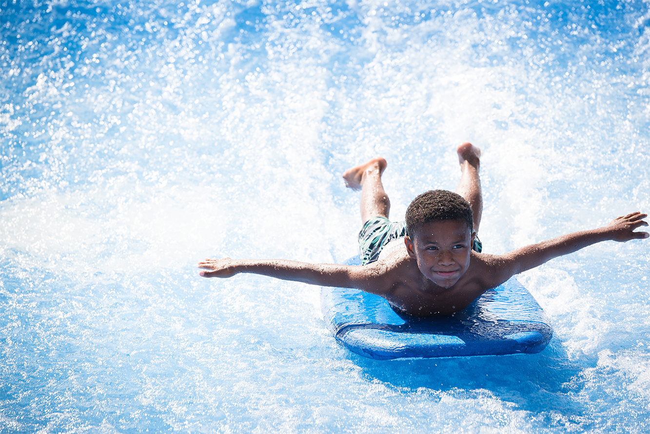 kid on flowrider surf ride