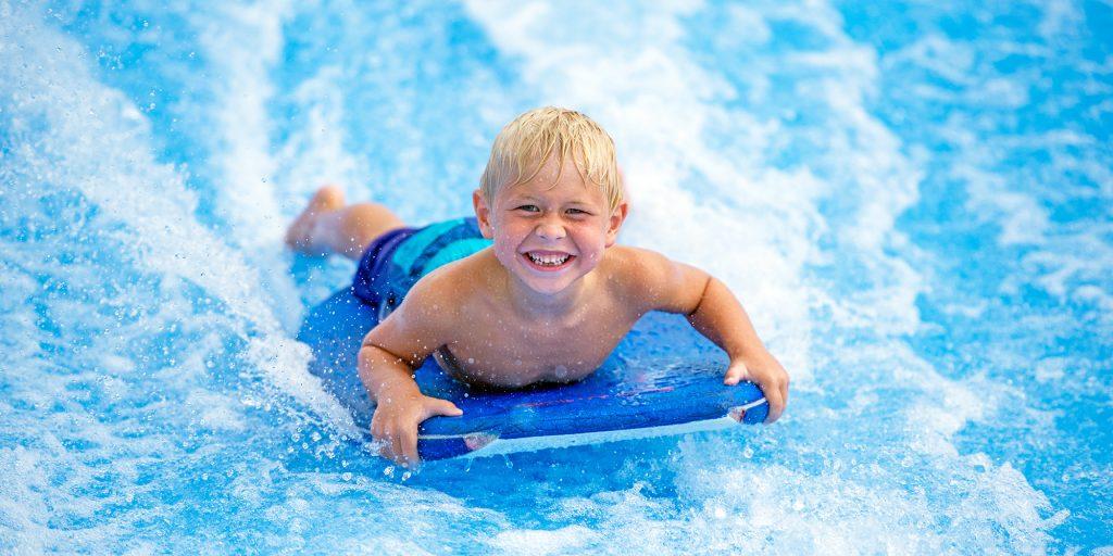 flowrider kid surfing