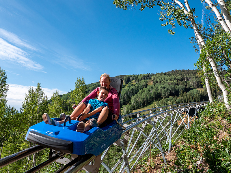 two people riding an adg mountain coaster