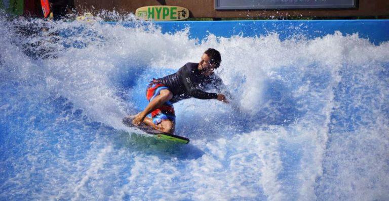 boy riding flowrider at splash lagoon water park