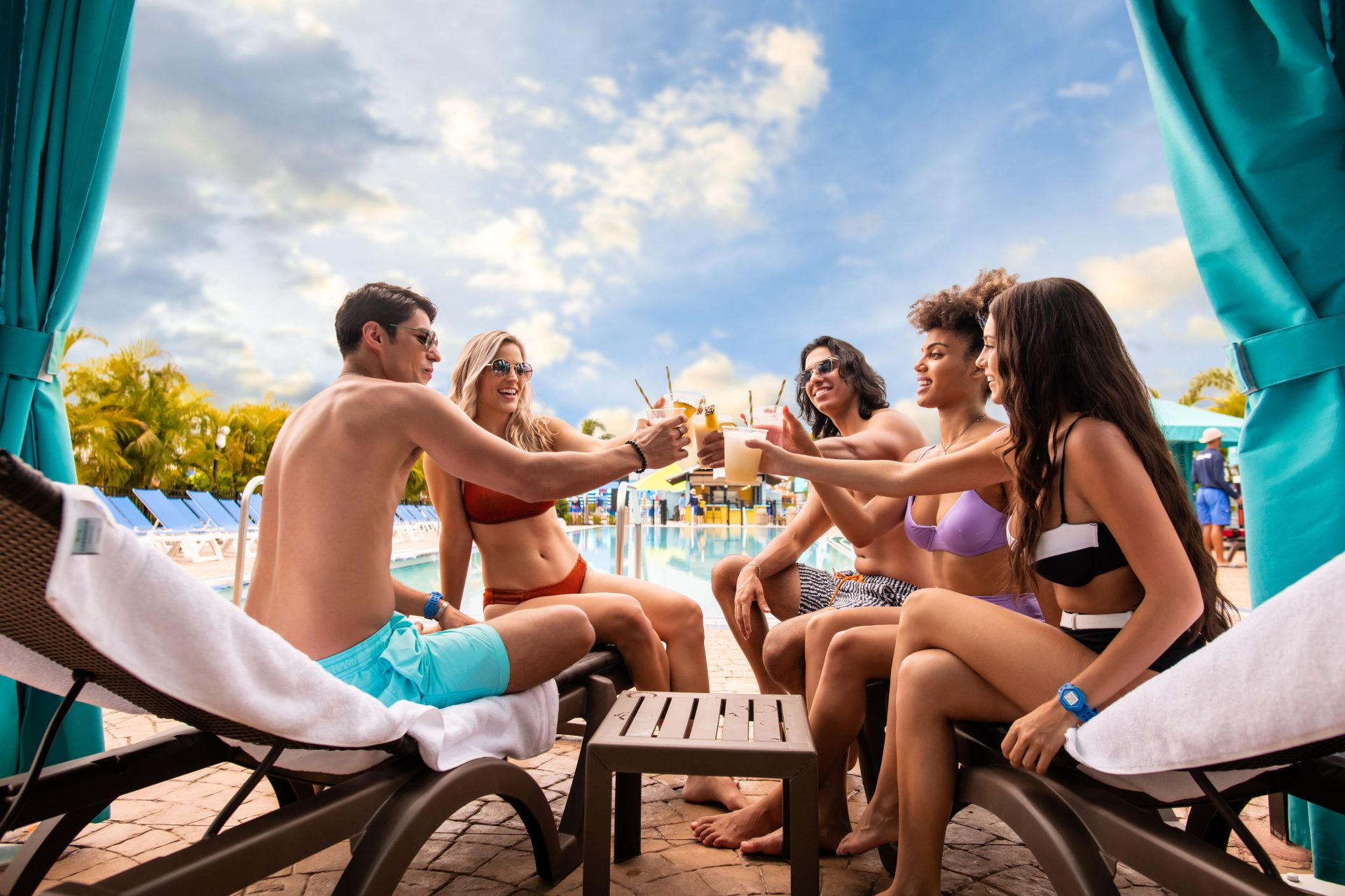 guests enjoying cocktails near water park pool