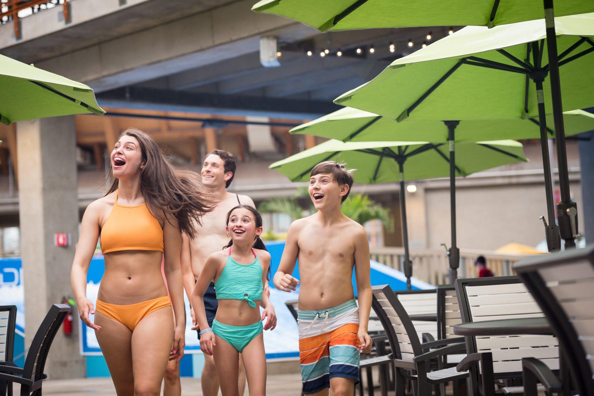 family walking through water park
