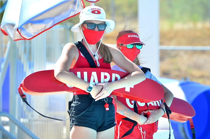 lifeguards with masks on