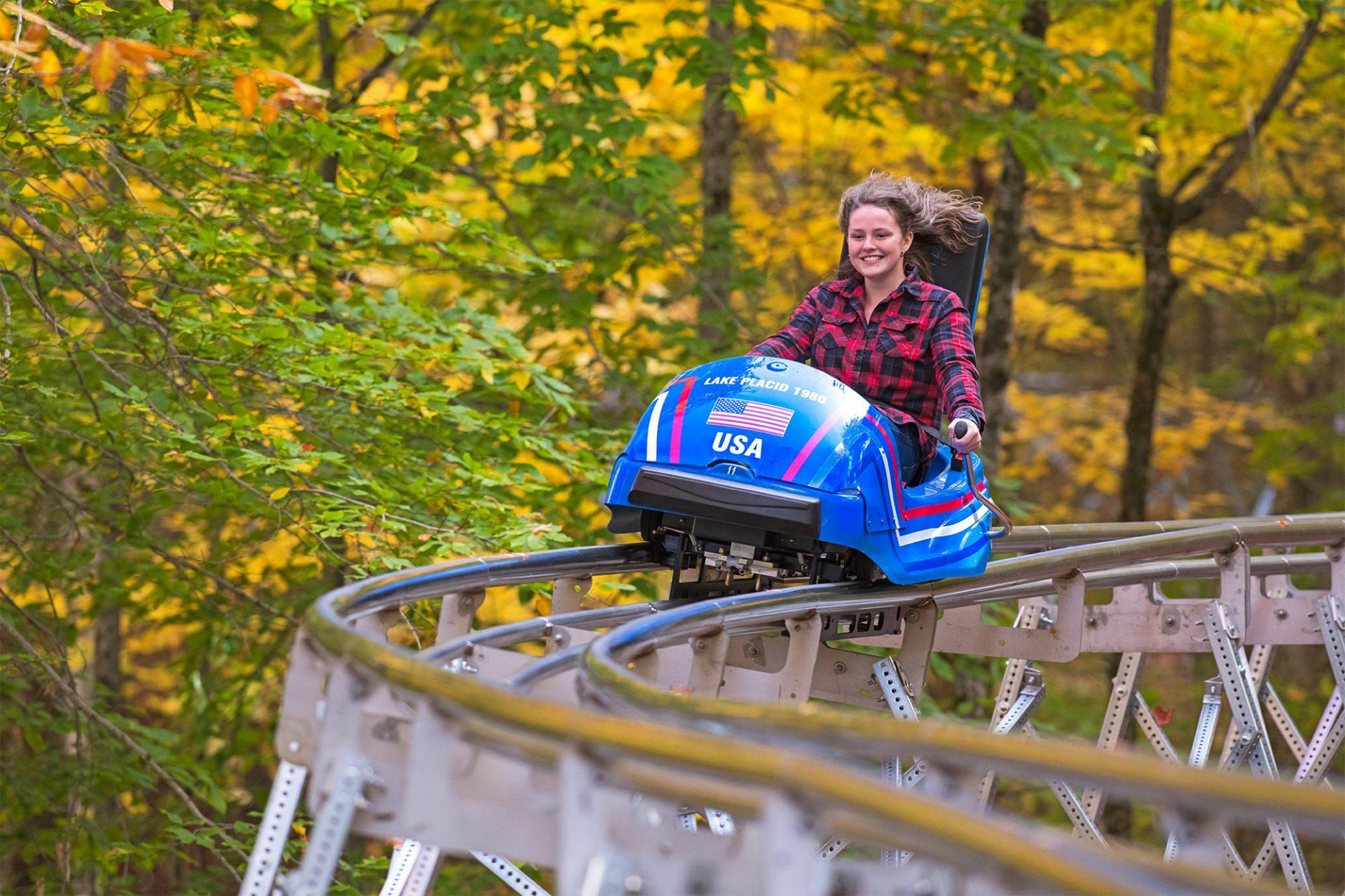 girl on mountain coaster track at orda lake placid