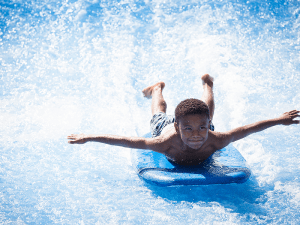 boy on flowrdier surf ride