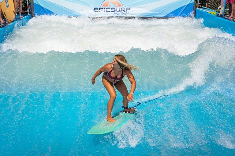 girl surfing on epicsurf wave